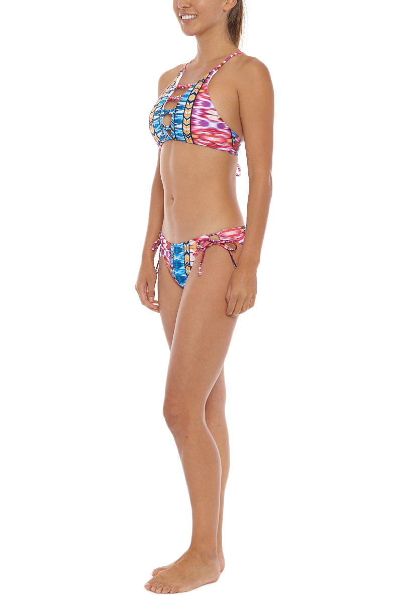 RAISINS Newport High Neck Bikini Top - Purple Sunset Print Bikini Top | Purple Sunset Print| Raisins Newport High Neck Bikini Top - Purple Sunset Print Side View. Strappy Front Cut Outs. Adjustable tie at back. Removable Padding.