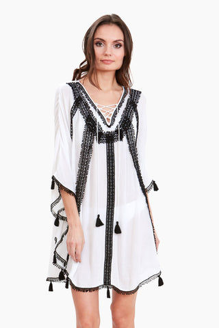 AMITA NAITHANI Vintage Riviera Lace Tunic - White/Black Cover Up | White/Black| Amita Naithani Vintage Riviera Lace Tunic - White/Black White tunic with black lace detail 3/4 sleeves V neckline  Front lace up detail Lace detail Tassel detail Front View