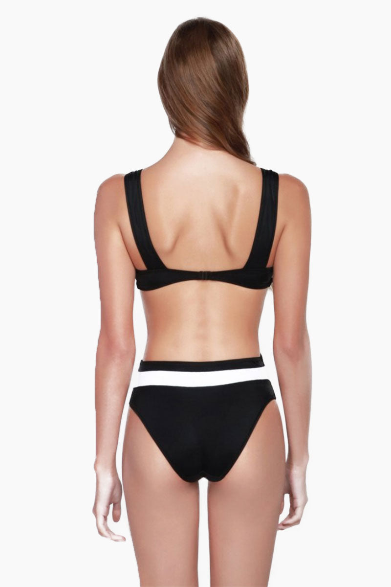 OYE SWIMWEAR Rorschach Cut Out One Piece Swimsuit - White & Black One Piece   White & Black  Oye Swimwear Rorschach Cut Out One Piece Swimsuit - White & Black. Features : Elegant Black and white cutout monokini one piece swimsuit. Named for the comic book character in the watchmen. Symmetrical color-blocked pattern looks like a one piece in front, but separates when seen from behind. Thick tank-top style straps and plunging scoop neckline with back clasp to secure fit and add an alluring silhouette. Fully lined. Suitable for D and DD cup sizes. Can be worn as a bodysuit.