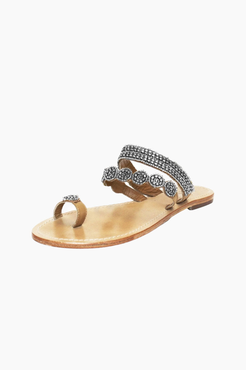 ASPIGA Rosa Sandals - Silver Sandals | Silver| Aspiga Rosa Sandals - Silver Toe loop style Over the foot straps with beadwork Non slip flat heel Genuine tan leather upper Hand crafted in India Angled View