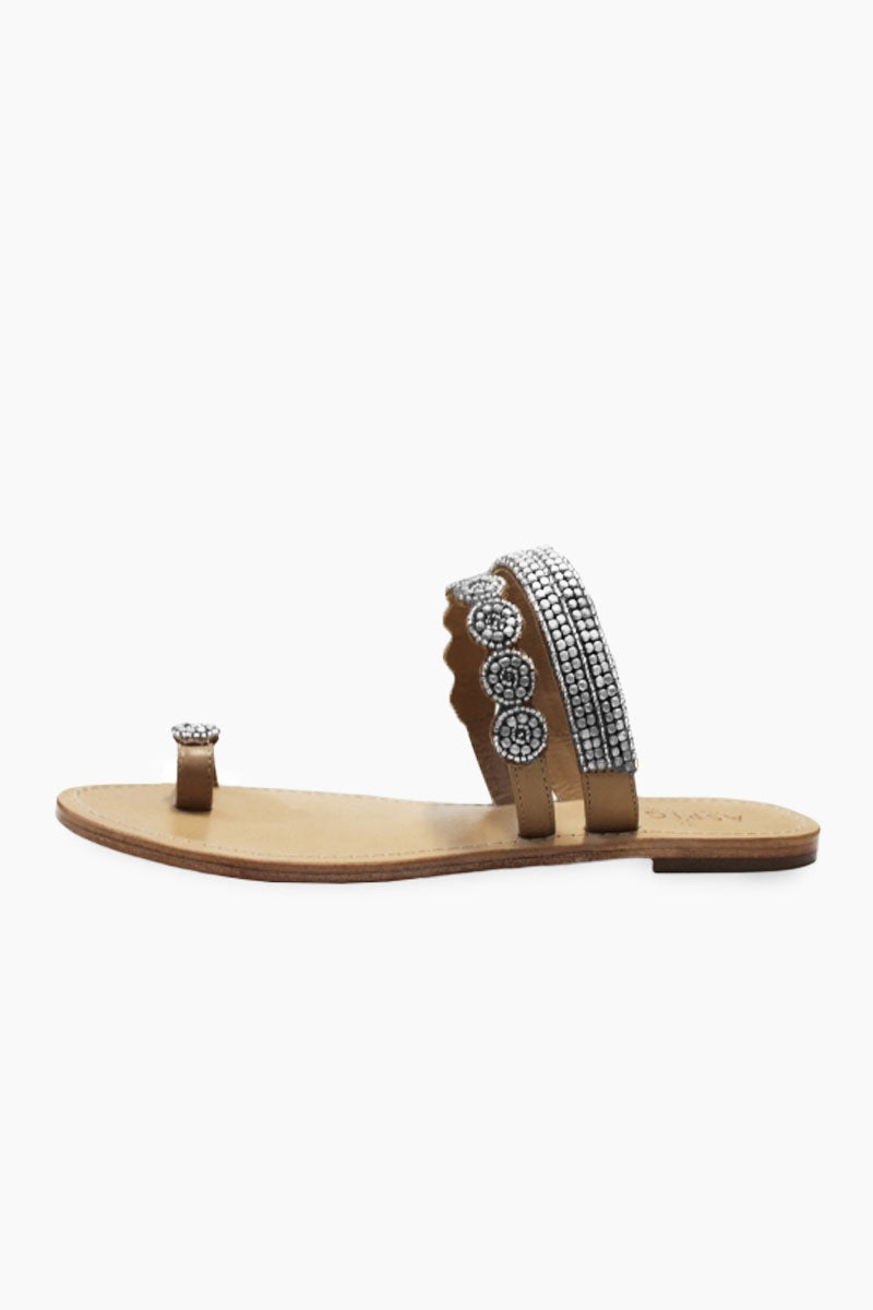 ASPIGA Rosa Sandals - Silver Sandals | Silver| Aspiga Rosa Sandals - Silver Toe loop style Over the foot straps with beadwork Non slip flat heel Genuine tan leather upper Hand crafted in India Side View