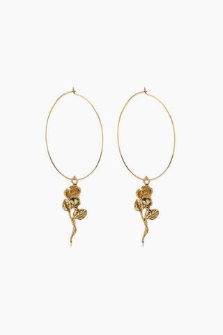 "LUV AJ Rosette Hoop Earrings - Gold Jewelry | Gold| Luv Aj Rosette Hoops - Gold Front View Thin wire statement hoops With a hanging Rose charm Sold as a pair Wire Hoops are 2"" tall and super thin Made from Brass Plated 14K Antique Gold"