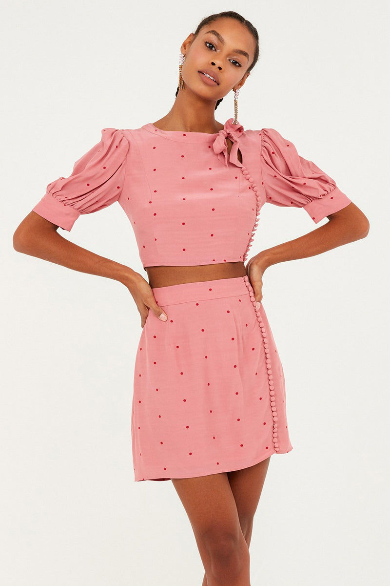 FOR LOVE AND LEMONS Rosie High Neck Button Up Crop Top - Rose Pink Polka Dot Print Top | Rose Dot Print|  For Love And Lemons Rosie High Neck Button Up Crop Top - Rose Pink Polka Dot Print  Features:  Button Detailing  Puff Sleeves with Cuff Exposed Back Zipper Closure Adjustable Tie Neckline Self: 65% Rayon/35% Viscose; Lining: 97% Polyester/3% Spandex Front View