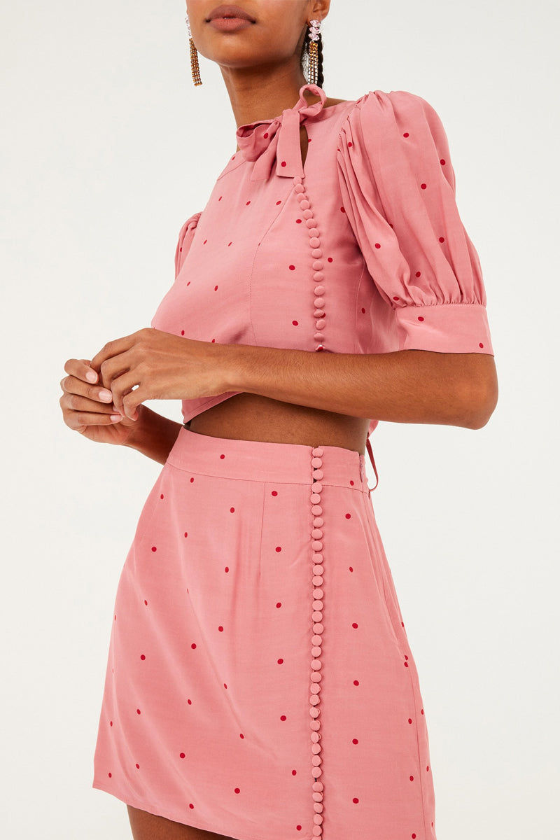 FOR LOVE AND LEMONS Rosie Button Up Mini Skirt - Rose Pink Polka Dot Print Skirt | Rose Pink Polka Dot Print| For Love And Lemons Rosie Button Up Mini Skirt - Rose Pink Polka Dot Print Features:  Button Detailing Front Slit at Hem Invisible Zipper Front View