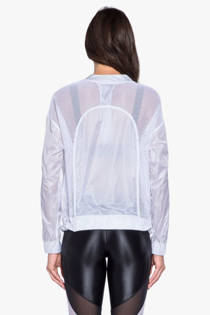 KORAL Rogue See-Through Jacket - White Jacket | White| Koral Rogue See-Through Jacket - White Features:  Zip-up jacket with adjustable waistband.  Meant for Athleisure performance. Fabric 1: Zephyr - 100% Polyester  Fabric 2: Open Mesh - 90% Polyamide, 10% Elastane Machine wash cold, inside out with like colors; No bleach; Tumble dry low. MADE IN USA Back View