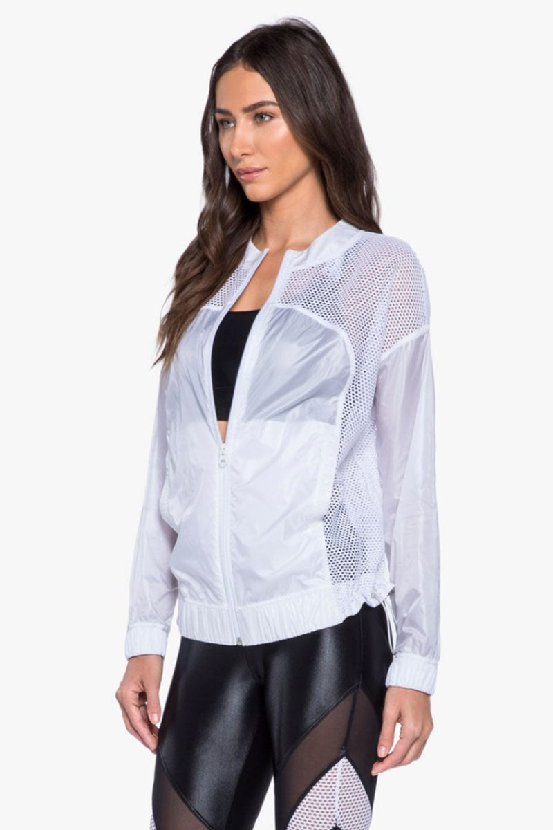 KORAL Rogue See-Through Jacket - White Jacket | White| Koral Rogue See-Through Jacket - White Features:  Zip-up jacket with adjustable waistband.  Meant for Athleisure performance. Fabric 1: Zephyr - 100% Polyester  Fabric 2: Open Mesh - 90% Polyamide, 10% Elastane Machine wash cold, inside out with like colors; No bleach; Tumble dry low. MADE IN USA Front View