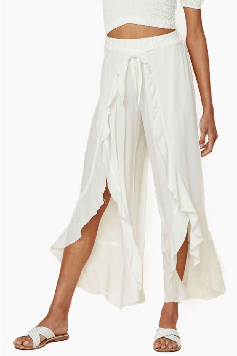 BLUE LIFE Ruffle Culotte Pants - Ivory Pants |  Ivory| Blue Life Ruffle Culotte Pants - Ivory. Features:  Ruffle Culotte Elastic waistband Wrap style tie closure Loosely flowing silhouette Ruffled trim through High waisted Made in USA Dry Clean Only 100% Rayon Front View