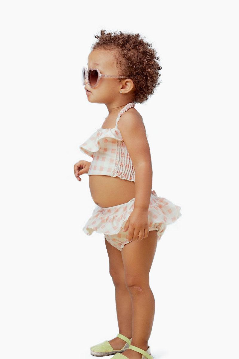 LIL LEMONS Ruffle Swim Bikini Bottom (Kids) - Pink Gingham Kids Bikini | Pink Gingham| LIL LEMONS Ruffle Swim Bikini Bottom (Kids) - Pink Gingham. Features:  Ruffle swim bottom Stylish gingham print Supple waistband Smocked leg openings Playful ruffled waist Side View
