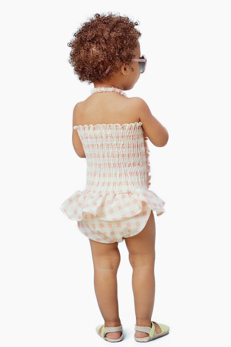 LIL LEMONS Ruffle Swim One Piece (Kids) - Pink Gingham Kids One Piece |  Pink Gingham| LIL LEMONS Ruffle Swim One Piece (Kids) - Pink Gingham. Features: •	Cute gingham print •	Ruffle detailing throughout •	Playful ruffled skirt •	Adjustable halter straps Back View