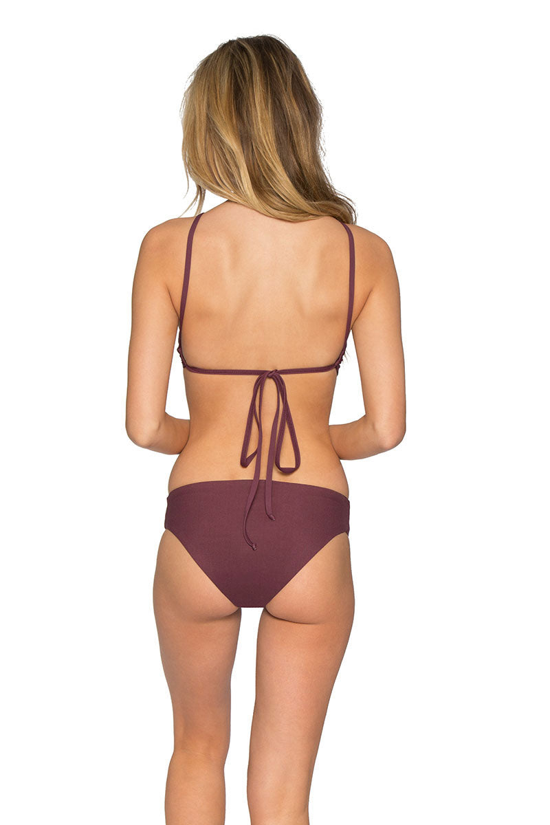 TAVIK Ryan Ribbed Sporty High Neck Bikini Top - Deep Ruby Red Bikini Top | Deep Ruby Red| Tavik Ryan Ribbed Sporty High Neck Bikini Top - Deep Ruby Red High neck bikini top in ribbed merlot. Trendy ribbed texture stretch swim fabric in elegant deep purple-red will have you dreaming of sipping wine on far off shores. High neck frames your face and shows off your sunkissed shoulders. Ties at the back for an easily adjustable fit. Offers moderate bust coverage and support with a flirty open back will let you play hard while feeling sexy. Back View