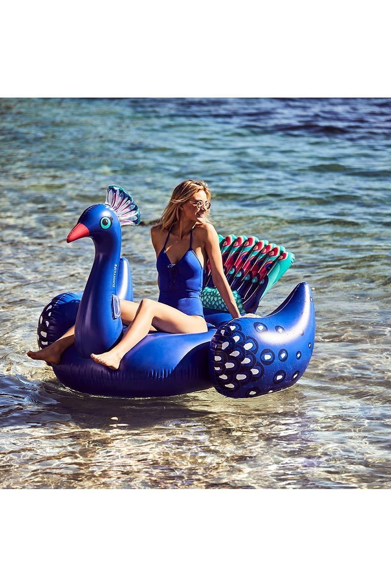 SUNNYLIFE Ride-On Float - Peacock Pool Accessories | Peacock| Sunnylife Ride-On Float - Peacock Lifestyle View