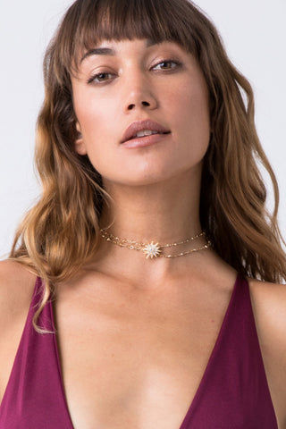 "LUV AJ Sunburst Hanging Choker - Gold Jewelry | Gold| Luv Aj Sunburst Hanging Choker - Gold.Features:  Double Choker with Hanging Crystal and Sunburst Detail  Fits like a True Choker  Easily Adjustable with 3"" Extender Chain  Made From Brass with Swarovski Crystals Plated in Gold Front View"