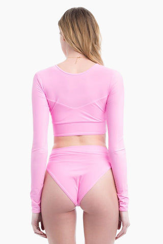 ELLE MER Sandbar High Neck Ribbed Long Sleeve Cropped Rashguard - Millennial Pink Bikini Top | Millennial Pink |Sandbar Rashguard - Features:  Three panel design Invisible lining over bust panel Tapered longsleeves SPF 50 protection Cropped style
