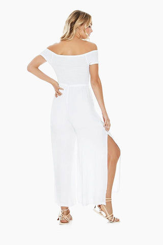 L SPACE Sao Paulo Off Shoulder Jumpsuit - White Jumpsuit | White| L Space Sao Paulo Jumpsuit - White. Pull-on jumper Off-the-shoulder cut Lace-up front with gold grommets High front leg slits Lined 100% viscose Hand wash in cold water. Lay flat to dry. Back View