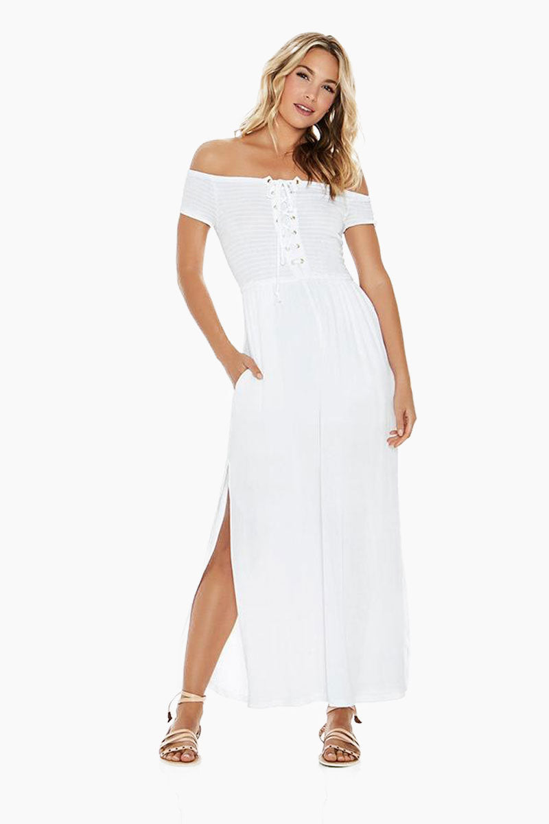 L SPACE Sao Paulo Off Shoulder Jumpsuit - White Jumpsuit | White| L Space Sao Paulo Jumpsuit - White. Pull-on jumper Off-the-shoulder cut Lace-up front with gold grommets High front leg slits Lined 100% viscose Hand wash in cold water. Lay flat to dry. Front View