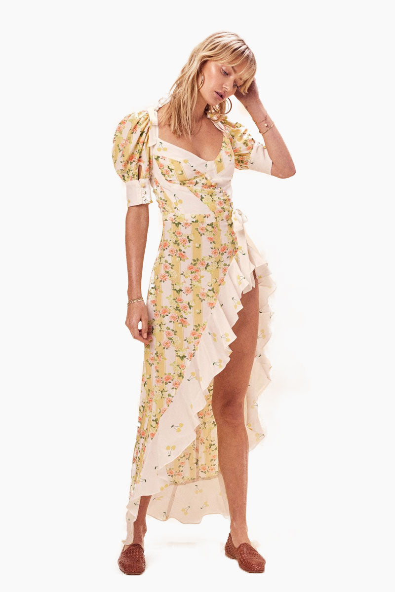 FOR LOVE AND LEMONS Savannah Maxi Dress - Buttercreme Dress | Buttercreme| For Love And Lemons Savannah Maxi Dress - Buttercreme. •Mixed Prints •Asymmetrical High-low Hem with Contrast Ruffle •Soft Cups •Adjustable Shoulder Ties with Bow Detail •Puff Elasticated Sleeves •Invisible Back Zipper Front View