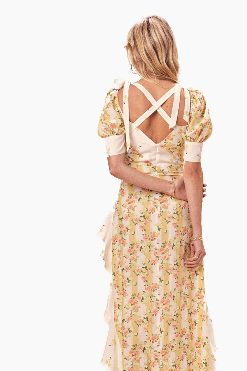 FOR LOVE AND LEMONS Savannah Maxi Dress - Buttercreme Dress | Buttercreme| For Love And Lemons Savannah Maxi Dress - Buttercreme. •Mixed Prints •Asymmetrical High-low Hem with Contrast Ruffle •Soft Cups •Adjustable Shoulder Ties with Bow Detail •Puff Elasticated Sleeves •Invisible Back Zipper Back View