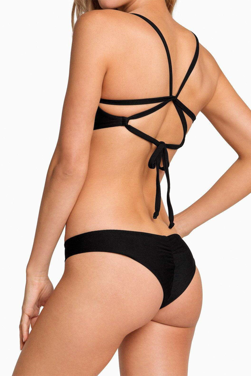 BOYS + ARROWS Clairee Cheeky Ruched Bikini Bottom - Black Bikini Bottom | Black| Boys + Arrows Clairee Cheeky Ruched Bikini Bottom - Black Low-rise scrunch butt seamless hipster bikini bottom. Wide side straps provide an ultra-comfortable fit that never digs in. Ruched center seam at back Back View