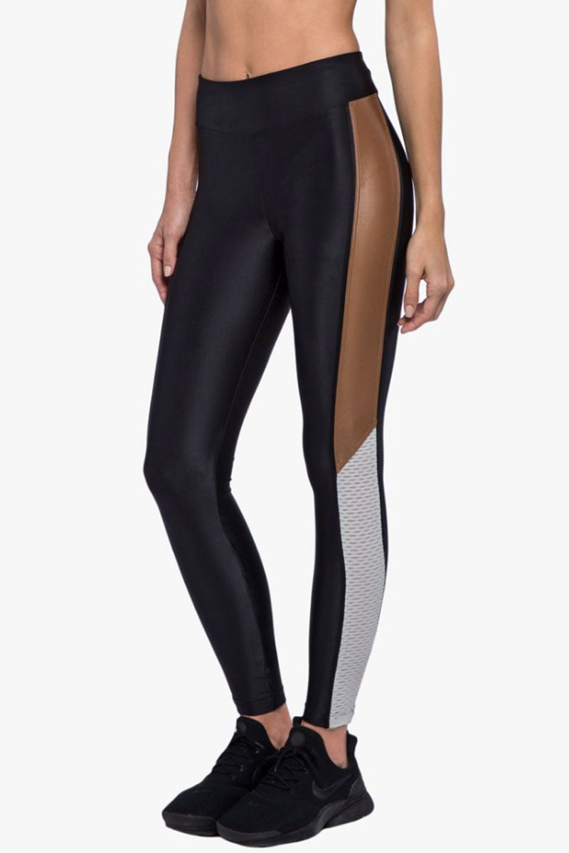 KORAL Serendipity High-Rise Energy Leggings - Black/Toffee/Egret Leggings   Black/Toffee/Egret  Koreal Serendipity High-Rise Energy Leggings - Black/Toffee/Egret. Features:  High rise Ankle length V-shaped waistband Moderate support Color Absolute anti-fade technology  Fabric 1: Energy - 74% Nylon, 26% Spandex Fabric 2: Netz - 89% Polyamide, 11% Lycra Fabric 3: Infinity - 85% Polyamide, 15% Xtra Life Lycra MADE IN USA Front View