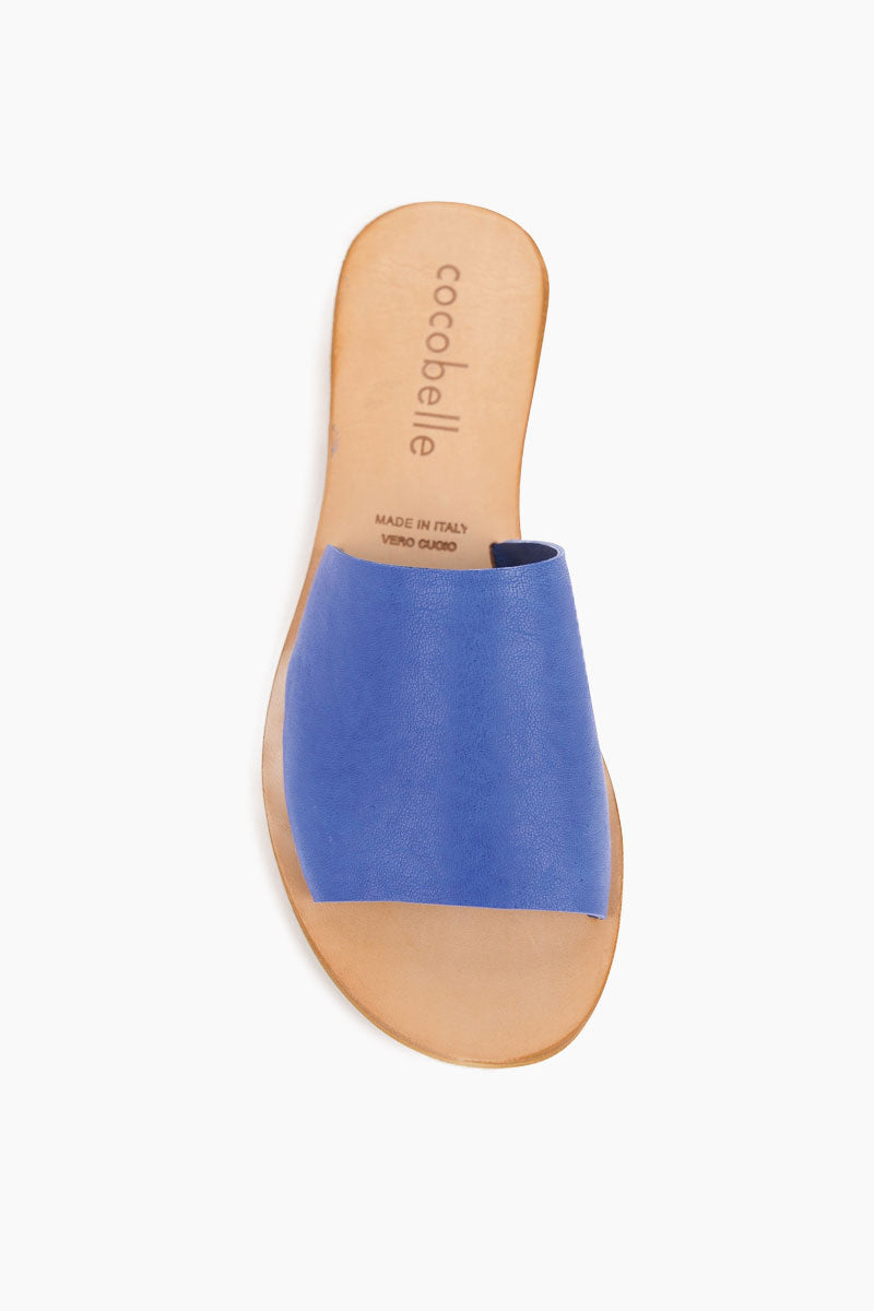 COCOBELLE Bhea Slides - Blue Sandals | Blue| Cocobelle Bhea Slides - Blue. Features: This beautifully minimal slide sandal will go with just about anything. Handmade in Italy, these sandals are made of 100% leather and will only get better with age.   Handmade in Italy 100% Leather Front View