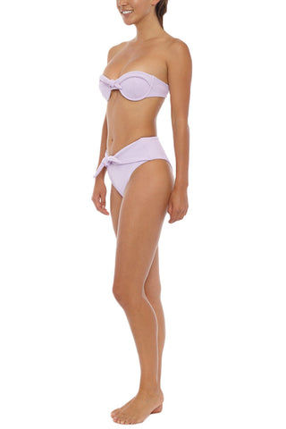 SKYE & STAGHORN Tie Front Bandeau Bikini Top - Rhapsody Lilac Purple Bikini Top | Rhapsody Lilac Purple| SKYE & STAGHORN Tie Front Bandeau Bikini Top - Rhapsody Lilac Purple Strapless bandeau  Shaped cup with underwire and padding  Fully lined  Front tie up detail Buttery textured lycra  80% Nylon, 20% Spandex  Front View