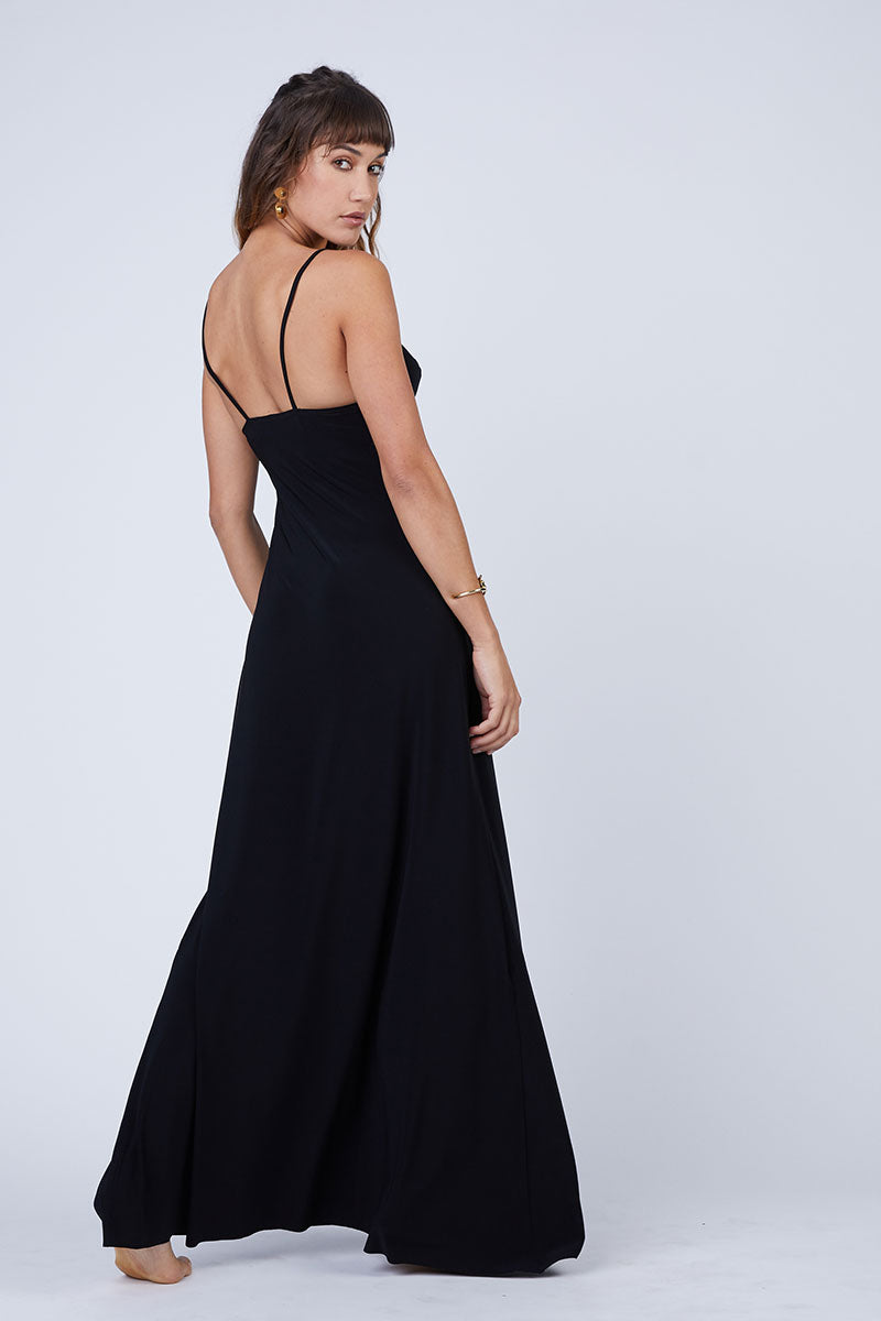 NORMA KAMALI Slip A Line Long Dress - Black Dress | Black| Norma Kamali Slip A Line Long Dress - Black Flowy spaghetti strap maxi dress in solid black stretch jersey fabric. Thin slip straps and tank-style v-neckline frame your face and flatter your decolletage. Lightly pleated floor-length maxi skirt flows in a pretty a-line silhouette. Back View