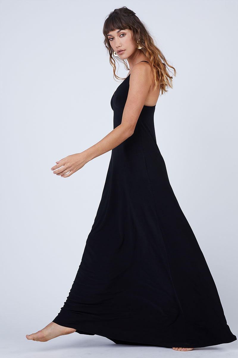 NORMA KAMALI Slip A Line Long Dress - Black Dress | Black| Norma Kamali Slip A Line Long Dress - Black Flowy spaghetti strap maxi dress in solid black stretch jersey fabric. Thin slip straps and tank-style v-neckline frame your face and flatter your decolletage. Lightly pleated floor-length maxi skirt flows in a pretty a-line silhouette. Side View