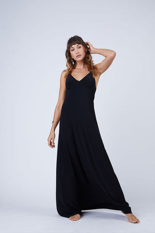 NORMA KAMALI Slip A Line Long Dress - Black Dress | Black| Norma Kamali Slip A Line Long Dress - Black Flowy spaghetti strap maxi dress in solid black stretch jersey fabric. Thin slip straps and tank-style v-neckline frame your face and flatter your decolletage. Lightly pleated floor-length maxi skirt flows in a pretty a-line silhouette. Front View