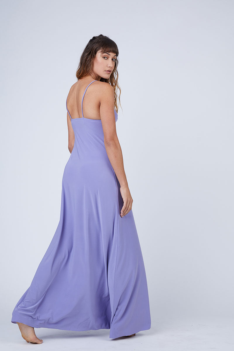 NORMA KAMALI Slip A Line Long Dress - Pastel Purple Dress | Pastel Purple| Norma Kamali Slip A Line Long Dress - Pastel Purple Flowy spaghetti strap maxi dress in pastel purple stretch jersey fabric. Thin slip straps and tank-style v-neckline frame your face and flatter your decolletage. Lightly pleated floor-length maxi skirt Back View