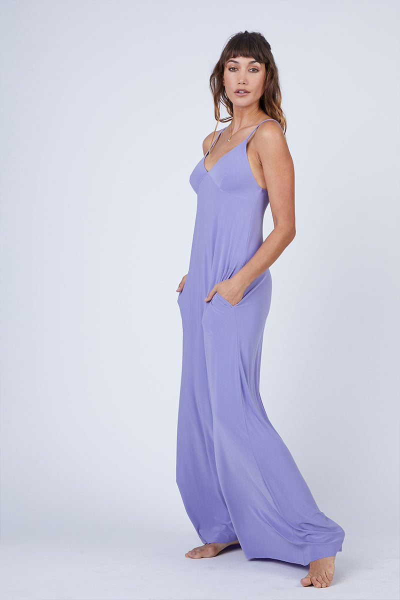NORMA KAMALI Slip A Line Long Dress - Pastel Purple Dress | Pastel Purple| Norma Kamali Slip A Line Long Dress - Pastel Purple Flowy spaghetti strap maxi dress in pastel purple stretch jersey fabric. Thin slip straps and tank-style v-neckline frame your face and flatter your decolletage. Lightly pleated floor-length maxi skirt Front View