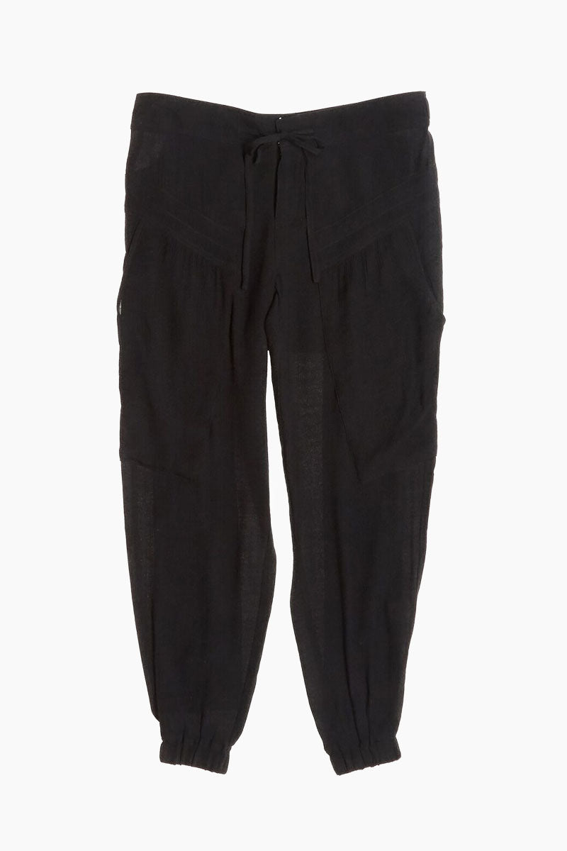 THE ODELLS Slouch Pants - Black Pants | Black| The Odells Slouch Pants - Black Elasticized waist band with hook and zip closure Drawstring tie at waist Deep front pockets Elastic cuffs 76% Rayon, 24% Nylon (textured cypress crinkle) Front View