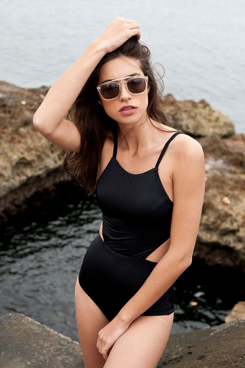 RVCA Solid Cut Out One Piece Swimsuit - Black One Piece | Black | RVCA Solid Cut Out One Piece - Black Slight Scoop Neckline  Shelf Bra with Removable Bra Cups Elastic Undercuts Binding Hook Back Closure Side Cut Outs Adjustable Shoulder Straps Moderate Coverage 80% polyamide, 20% elastane Side View