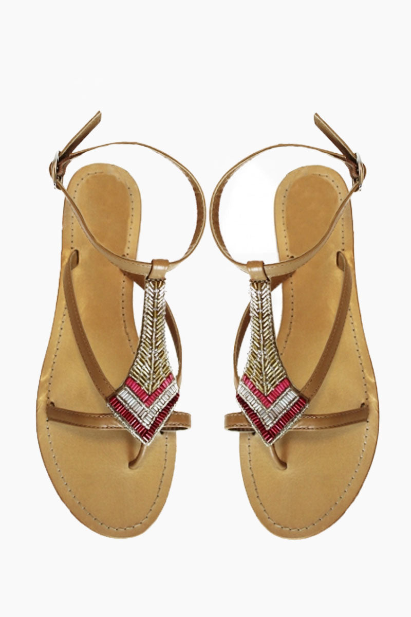 ASPIGA Sresha Sandals - Red Sandals | Red| Aspiga Sresha Sandals - Red Strappy, toe post design Diamond shaped beadwork detail in shades of rich reds and metallic golds Adjustable ankle straps Non slip flat heel Genuine tan leather upper Front View