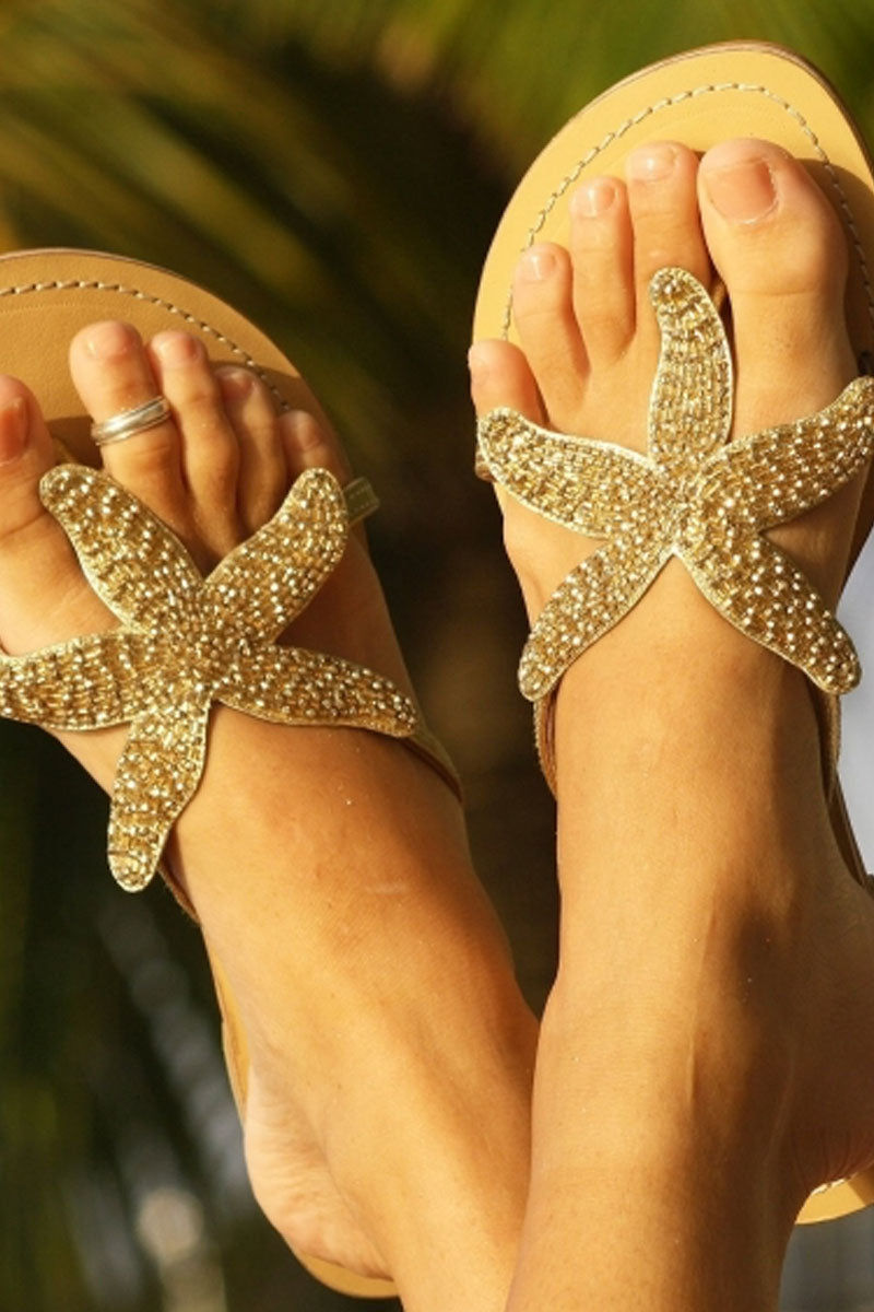 ASPIGA Starfish Sandals - Gold Sandals | Gold| Aspiga Starfish Sandals - Gold Flip flop style Gold beaded starfish design  Non slip heel Genuine tan leather upper Hand crafted  Front View View