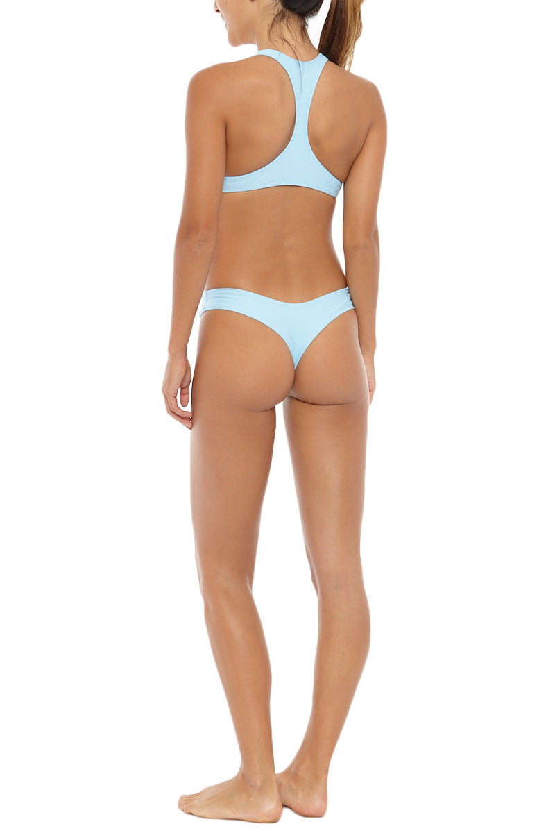 STONE FOX SWIM Loni Sporty T Back Bikini Top - Sky Blue Bikini Top | Sky Blue| Stone Fox Swim Loni Sporty T Back Bikini Top - Sky Blue porty scoop neck bralette strappy bikini top in sky blue. Ultra-flattering scoop neckline frames your décolletage and shows some skin. Wide, fixed shoulder criss-cross shoulder straps sit comfortably on your shoulders. Slim racerback design flatters your shoulder blades and provides extra bust support. Back View