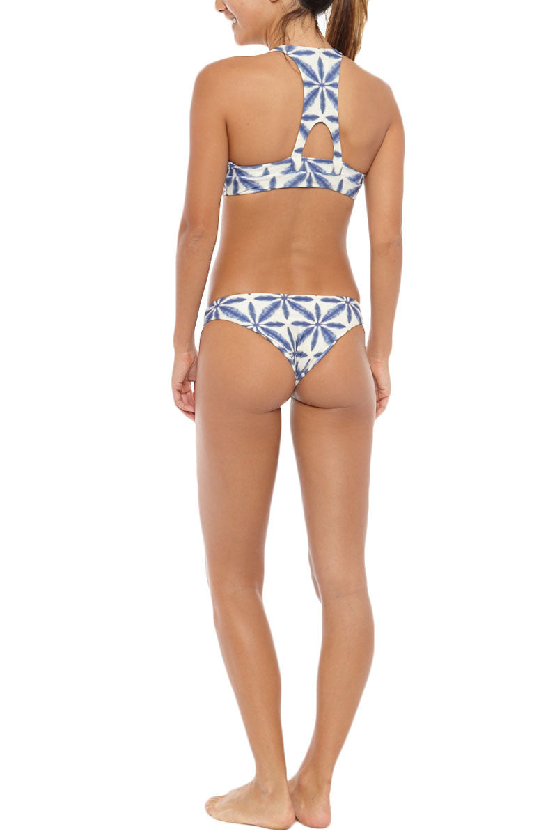STONE FOX SWIM La Jolla Sporty Monokini One Piece Swimsuit - Ocean Blue Batik Print One Piece   Ocean Blue Batik Print  Stone Fox Swim La Jolla Sporty Monokini One Piece Swimsuit - Ocean Blue Batik Print Large cut-outs at sides continue to the back to create a monokini silhouette, giving you the best of both a bikini cut and a one-piece swimsuit. Ultra-flattering, athletic high neckline with wide shoulder straps frames your shoulders and arms. Racerback cut exposes skin at the center of the back through a small cut-out. Moderate rear cut shows off your curves while providing cheeky coverage. Back View