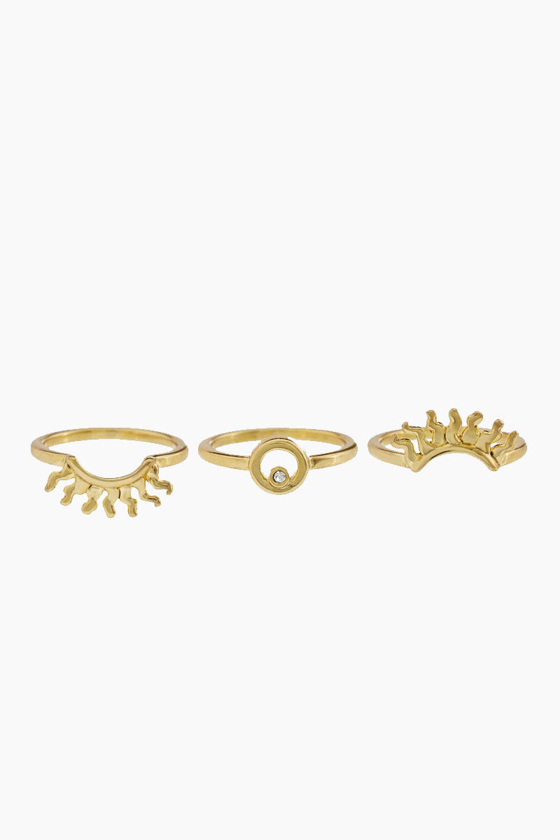 LUV AJ Sunburst Ring Set - Gold Jewelry | Gold| Luv Aj Sunburst Ring Set - Gold.Features:  Set of Rings with Sunburst and Crystal Detail  Sold as a Set of 3 The rings are meant to be stacked together Made From Brass with Swarovski Crystals Plated in Gold Front View