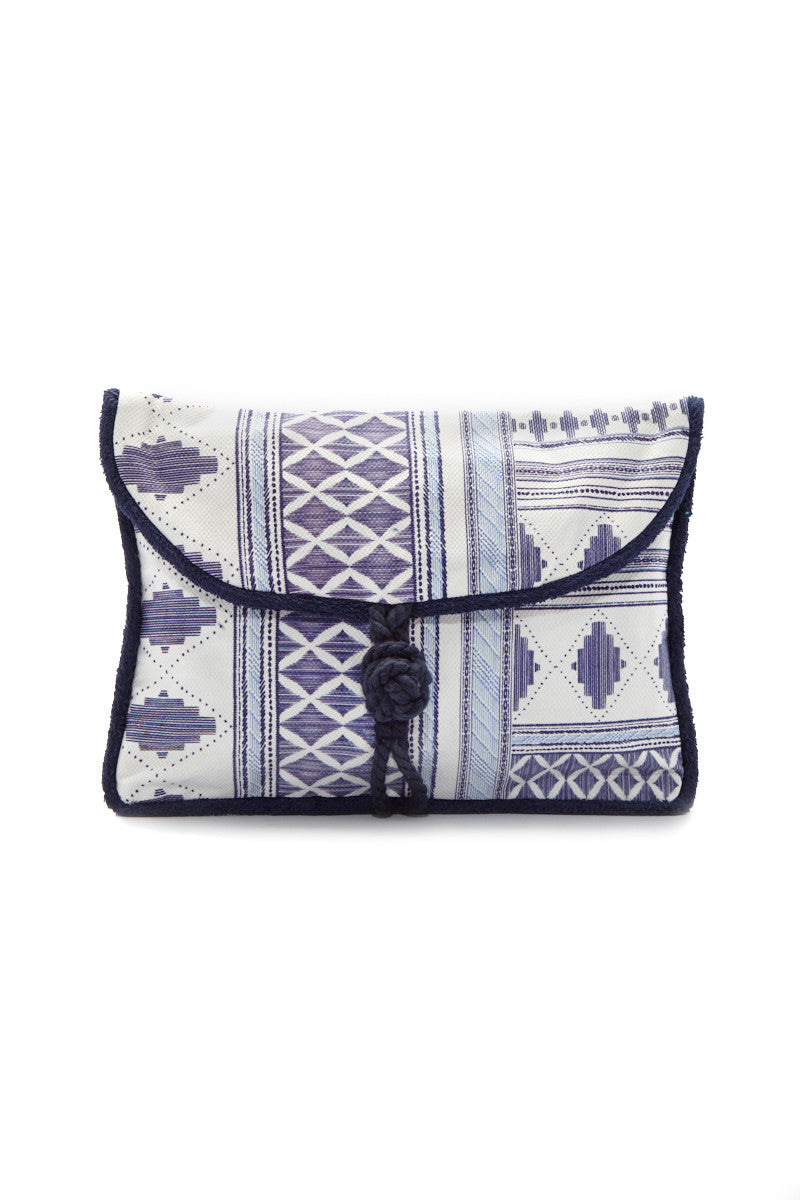 SUN OF A BEACH Caldera Pouch - Ocean Blue Geometric Print Bag | Ocean Blue Geometric Print| Sun Of A Beach Caldera Pouch - Ocean Blue Geometric Print Ocean blue geometric print beach pouch. Made from printed cotton canvas and lined with 100% Egyptian cotton towel. Decorated with a blue geometric print pattern Front View
