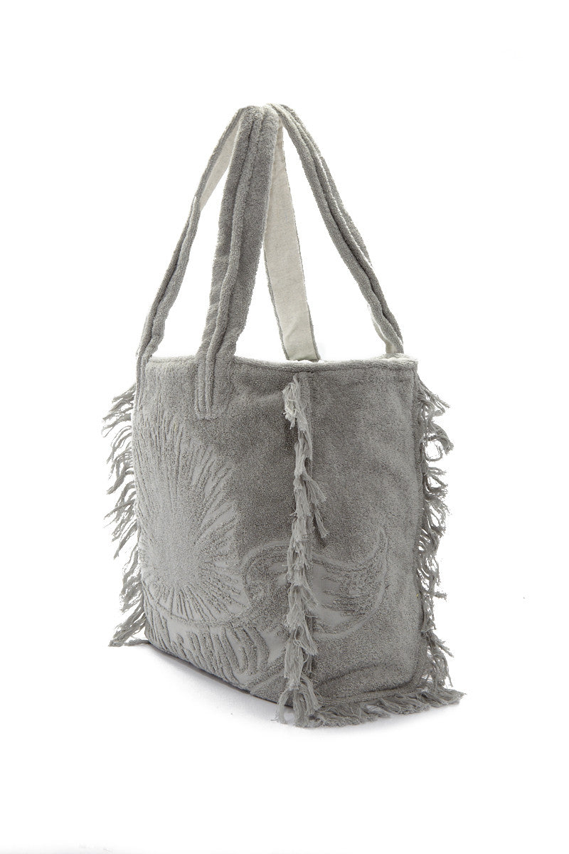 SUN OF A BEACH Fringe Poly Bag - Cool Grey Bag | Cool Grey| Sun Of A Beach Fringe Poly Bag - Cool Grey Cool grey multi-use poly bag with burnt out logo and fringe. Made from printed cotton canvas and lined with 100% Egyptian cotton towel, this bag can be folded and packed flat. Side View
