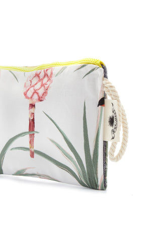 SUN OF A BEACH Pina Colada Passpartout Pouch - Tropical Paradise Print Bag | Tropical Paradise Print| Sun Of A Beach Pina Colada Passpartout Pouch - Tropical Paradise Print White tropical print multi-use pouch. This Hawaiian printed pouch brings paradise to every moment of the day. Made from printed cotton canvas, Side View