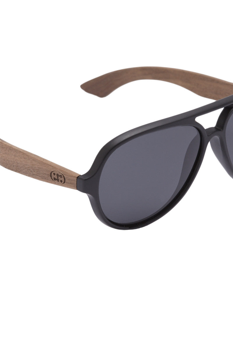 SURREAL SUNGLASSES Premium Walnut Wood Temple Sunglasses - Brown/Gray Sunglasses | Brown/Gray| Surreal Sunglasses Premium Walnut Wood Temple Sunglasses - Brown/Gray 100% lightweight natural eco-friendly walnut wood temples Plastic frame Scratch resistant polarized lens  Full UV A/B protection Side View