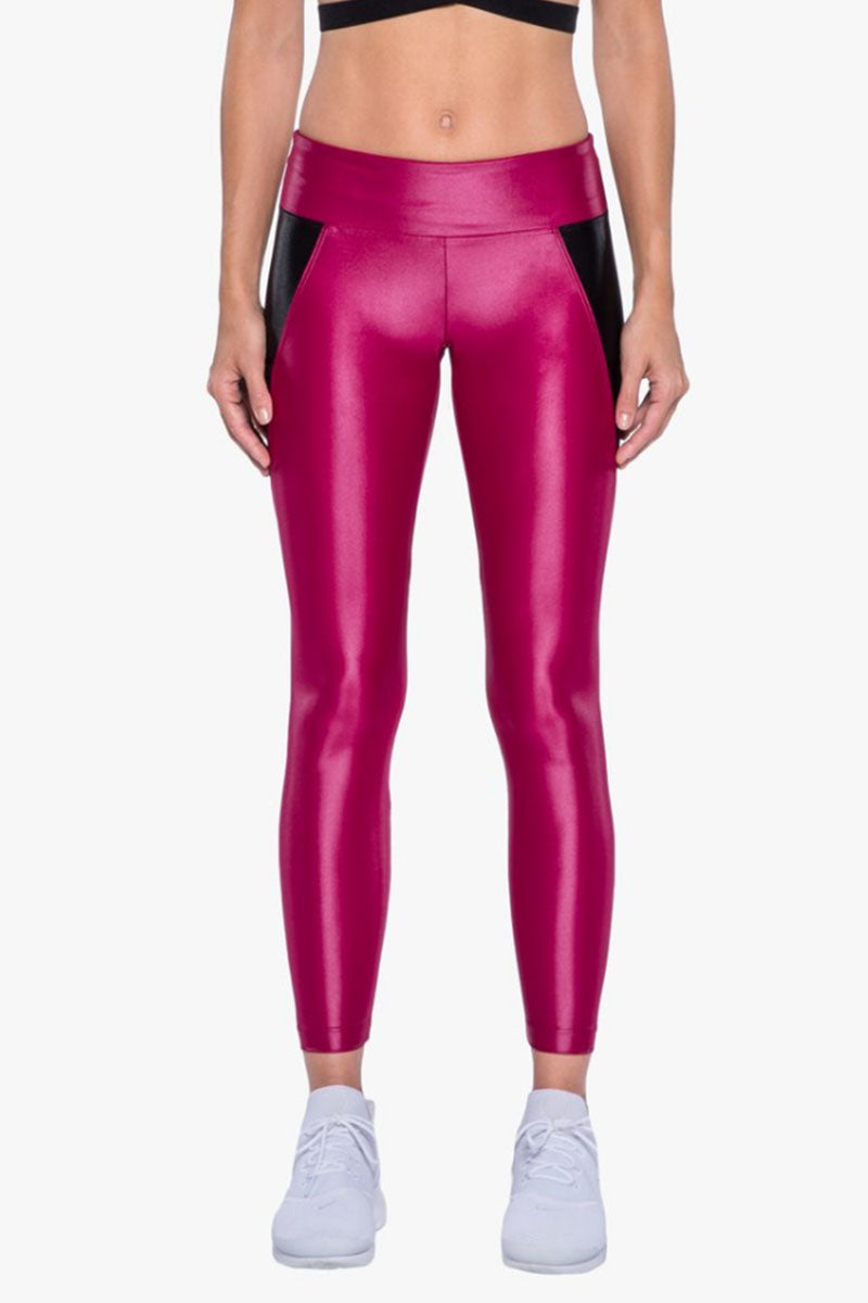 KORAL Surrey Infinity Leggings - Azalea/Black Leggings | Azalea/Black| Koral Surrey Legging - Azela Black. Features:  Mid-rise figure forming legging with side mesh pockets.  Signature Infinity fabric. Mid-rise figure-forming legging with side mesh pockets Meant for High performance.  Fabric 1: Infinity - 85% Polymide, 15% Xtra Life Lycra Sport Fabric 2: Power Mesh - 72% Nylon, 28% Elastane Technology: Chlorine resistant, Color absolute, H20 friendly, Quick drying Machine wash cold. Wash with like colors. Tumble dry low. No bleach. MADE IN USA Front View