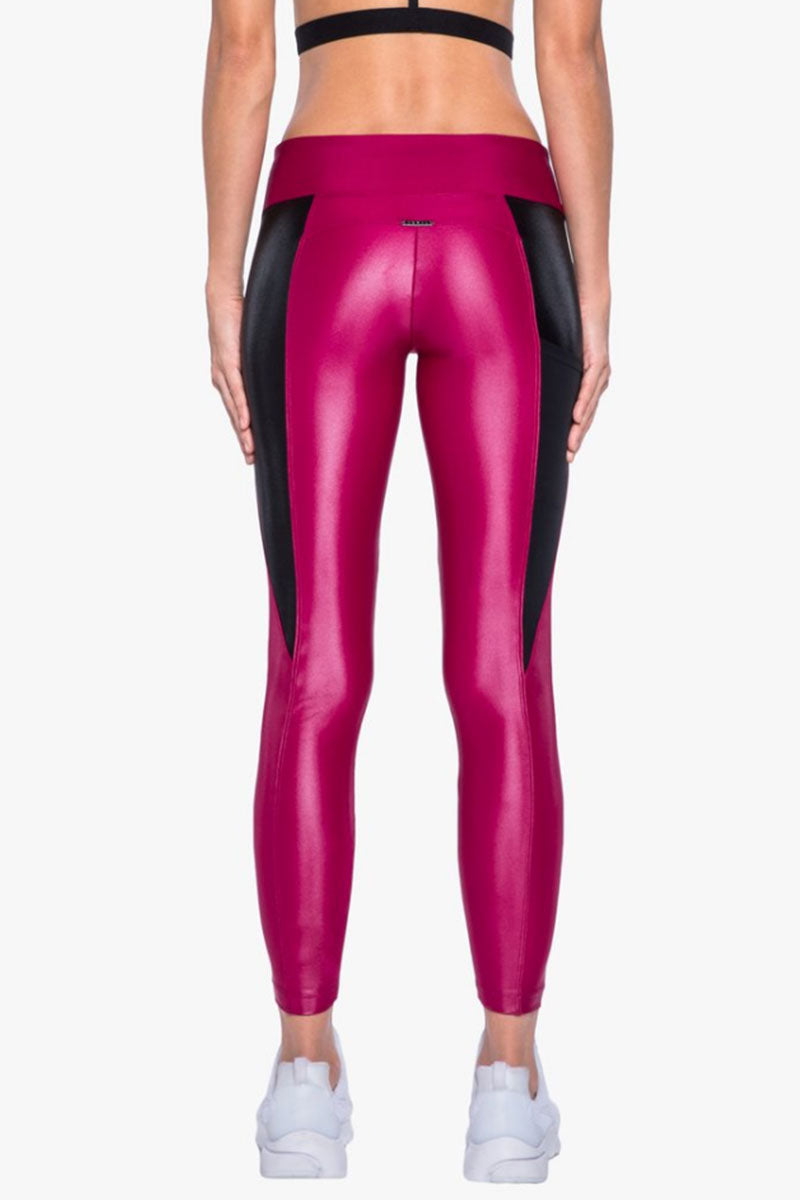 KORAL Surrey Infinity Leggings - Azalea/Black Leggings | Azalea/Black| Koral Surrey Infinity Leggings - Azalea/Black Features:  Mid-rise figure forming legging with side mesh pockets.  Signature Infinity fabric. Mid-rise figure-forming legging with side mesh pockets Meant for High performance.  Fabric 1: Infinity - 85% Polymide, 15% Xtra Life Lycra Sport Fabric 2: Power Mesh - 72% Nylon, 28% Elastane Technology: Chlorine resistant, Color absolute, H20 friendly, Quick drying Machine wash cold. Wash with like colors. Tumble dry low. No bleach. MADE IN USA Back View