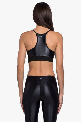 KORAL Sweeper Sports Bra - Black Activewear | Black| Koral Sweeper Sports Bra - Black. Features:  Scoop neck  Opaque shine Comfortable elastic band Medium performance H2O resistant  Made in USA Back View