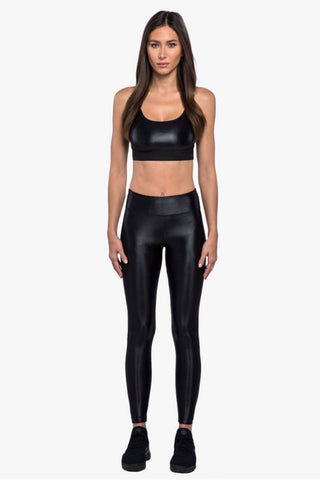 KORAL Sweeper Sports Bra - Black Activewear | Black| Koral Sweeper Sports Bra - Black. Features:  Scoop neck  Opaque shine Comfortable elastic band Medium performance H2O resistant  Made in USA Front View