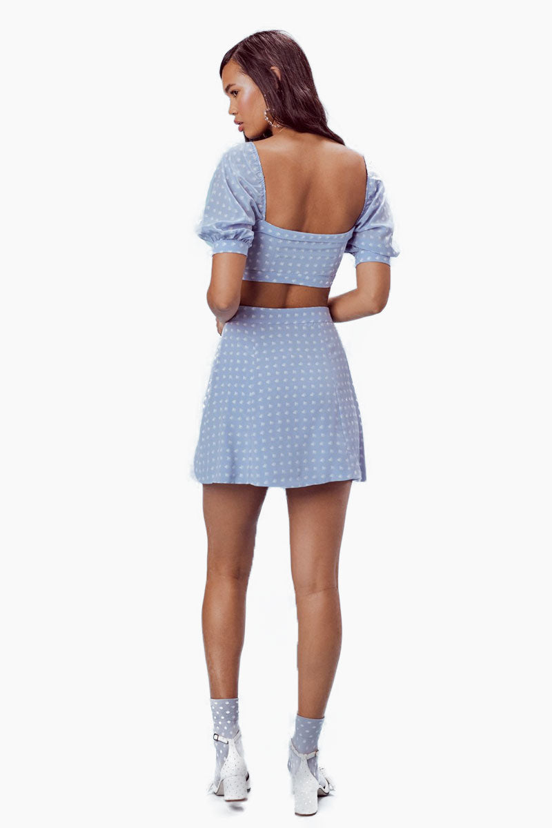 FOR LOVE AND LEMONS Sweetheart Mini Skirt - Periwinkle Skirt | Periwinkle|For Love And Lemons Sweetheart Mini Skirt - Periwinkle Features:  Center Front Button Closure Slits at Front Hem Dry Clean Only Self: 52% Rayon/45% Viscose; Lining: 100% Polyester Back View