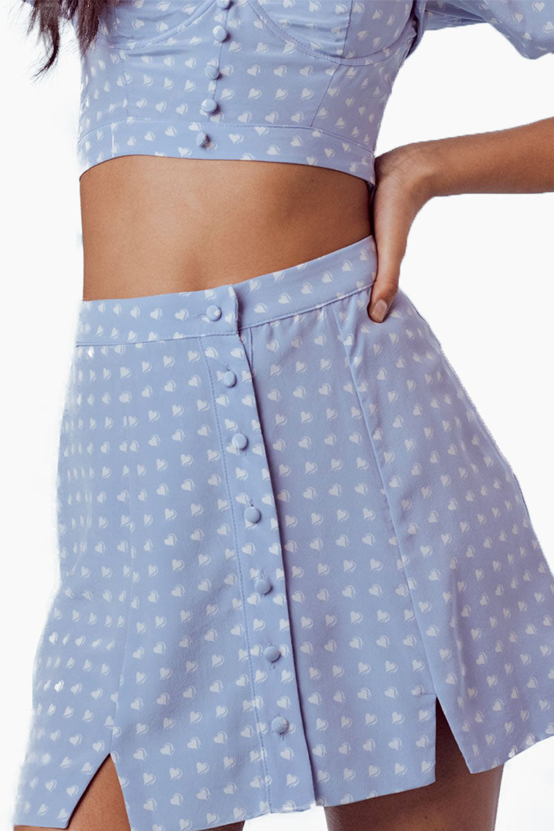 FOR LOVE AND LEMONS Sweetheart Mini Skirt - Periwinkle Skirt | Periwinkle|For Love And Lemons Sweetheart Mini Skirt - Periwinkle Features:  Center Front Button Closure Slits at Front Hem Dry Clean Only Self: 52% Rayon/45% Viscose; Lining: 100% Polyester Close Up View