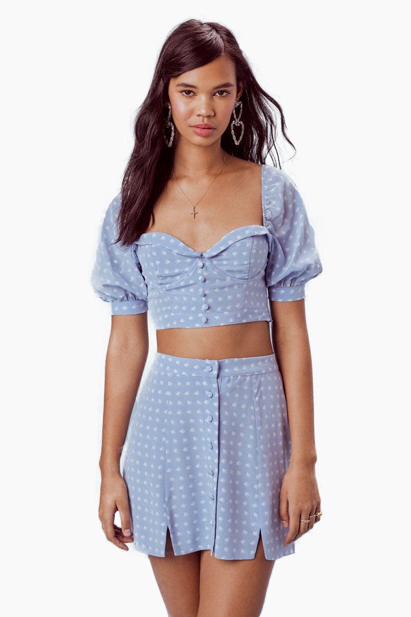 FOR LOVE AND LEMONS Sweetheart Mini Skirt - Periwinkle Skirt | Periwinkle|For Love And Lemons Sweetheart Mini Skirt - Periwinkle Features:  Center Front Button Closure Slits at Front Hem Dry Clean Only Self: 52% Rayon/45% Viscose; Lining: 100% Polyester Front View