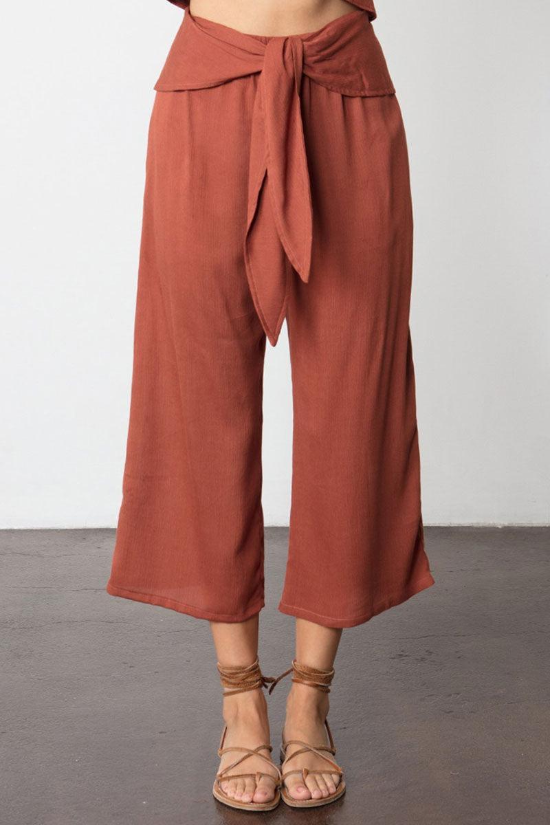 STILLWATER The Drifter High Waist Pants - Rust Orange Pants | Rust Orange| Stillwater The Drifter High Waist Pants - Rust Orange High Rise  Side Pockets  Loose Pants  Attached Belt For Front Tie  Content: Cotton Bubble Gauze Front View