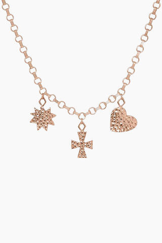 "LUV AJ The Hammered Charm Necklace - Rose Gold Jewelry | Rose Gold| Luv Aj The Hammered Charm Necklace - Rose Gold Statement chain with hammered charms- a cross, a heart, and a star Necklace is 30"" long with S clasp Can be worn as a necklace or belt Made from Brass Plated in Rose Gold Front View"